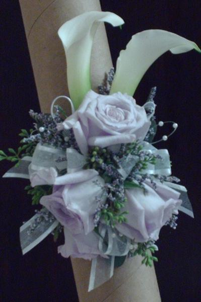 White calla lily's, lavender roses, filler, greenery, and ribbon