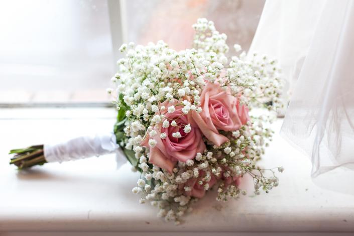 [Image: Light pink roses and baby's breath bouquet]