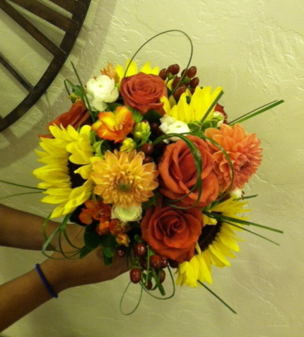 [Image: Sunflowers, dahlia's, roses,freesia, ranunculus, brown hypericum and greenery]