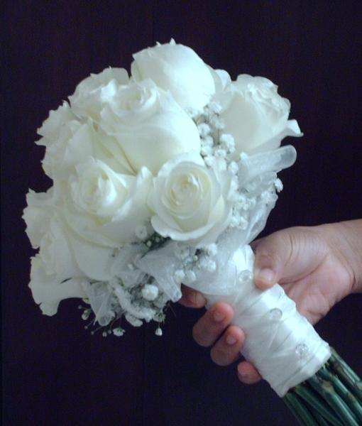 [Image: White roses,baby's breath, and white ribbon]