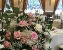 White rose, hydrangea, light pink rose, spray rose, and baby's breath