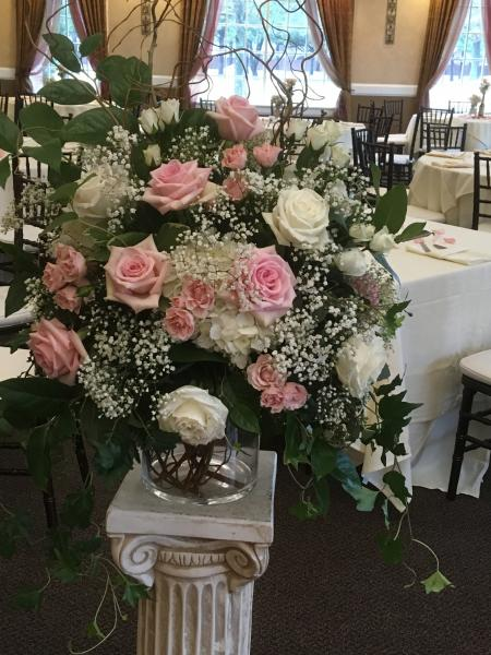 [Image: White rose, hydrangea, light pink rose, spray rose, and baby's breath]