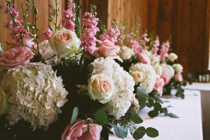 [Image: Light pink roses, stock, creme roses, white hydrangea, orchids and greenery]