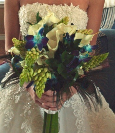 [Image: Not every bride is looking for a traditional bouquet, this bouquet showcases an unusual yet elegant display of of flowers.]