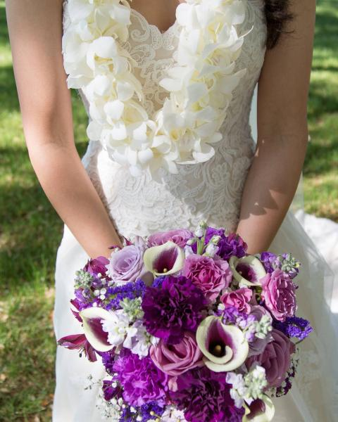 Lavender and Purple Brides Bouquet including roses, stock carnations, calla lillys, babys breath