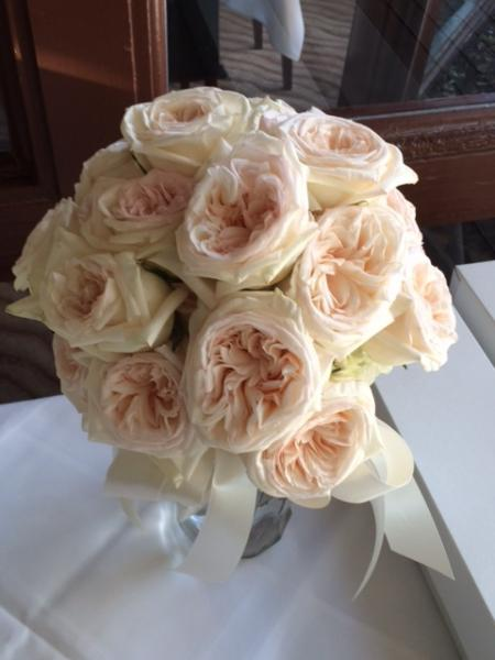 [Image: Elegant hand-tied garden rose bouquet with ivory satin ribbon]