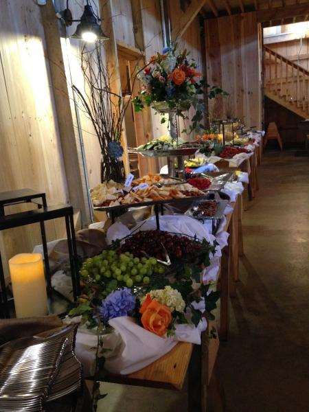 [Image: Make your serving tables, gift tables, and photo tables beautiful with flower arrangements that accentuate your venue and decor.]