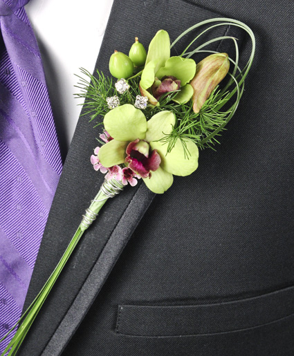 [Image: This green boutonniere features simple green flowers with unique greenery looping and crystal accents.]